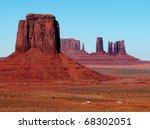 Bright terracotta mesas against blue sky - stock photo