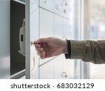 hand with key open locker in... | Shutterstock . vector #683032129