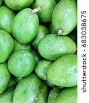 Small photo of background of green unripe fresh organic kedondong Ambarella Spondias dulcis on display for sale at local farmer's market, a tropical fruit from Malaysia good to quench thirst with vitamin juice