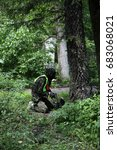 Small photo of paintball shooter in the european green forest