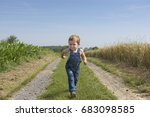 Angry Little Boy Running In Th...