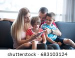 happy young family playing... | Shutterstock . vector #683103124