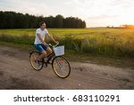 the guy rides a bicycle along a ... | Shutterstock . vector #683110291