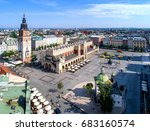 Main Market Square (Rynek), old cloth hall (Sukiennice), town hall tower, Church of St. Adalbert or St. Wojciech and renovated Mickiewicz statue in Krakow (Cracow) Poland. Aerial view.