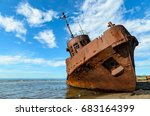 Old Rusty Ship On The Coast On...