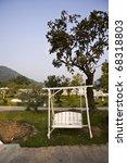 white wooden swing - stock photo