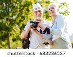 Smiling Elderly People Looking...