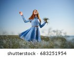 woman with flowers in a field... | Shutterstock . vector #683251954