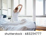 man stretching in bed  back view | Shutterstock . vector #683254777