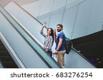 pleasant couple is standing on... | Shutterstock . vector #683276254
