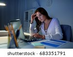 Stock photo business people deadline stress and technology concept businesswoman with laptop at night 683351791