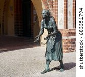 Small photo of TANGERMUENDE, GERMANY - JULY 19, 2017: Monument to Grete Minde at the town hall of Tangermuende. Grete was burnt as a firefighter on the pyre after a big fire in 1617