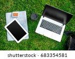 laptop computer on green grass...   Shutterstock . vector #683354581