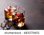 manhattan cocktail with whiskey.... | Shutterstock . vector #683370601