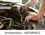 Auto Mechanic Working Under The ...