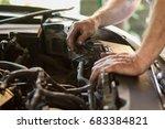 auto mechanic working under the ... | Shutterstock . vector #683384821