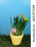 easter egg inside a pot of grass | Shutterstock . vector #683397289