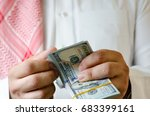 saudi man counting thousands us ... | Shutterstock . vector #683399161