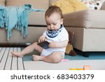 little baby playing with a... | Shutterstock . vector #683403379
