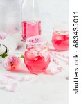 Stock photo summer refreshment drinks light pink rose cocktail with rose wine tea rose petals lemon on a 683435011