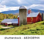 Red Barn And Silo With A...