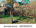 Old Rusty Plow On The Field
