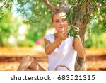 nice blond woman sitting in the ... | Shutterstock . vector #683521315