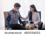 a female doctor examining a... | Shutterstock . vector #683556031