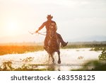 cowboy on horseback on water... | Shutterstock . vector #683558125
