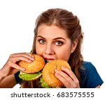 woman eating two hamburgers.... | Shutterstock . vector #683575555