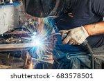 a man welder in a black t shirt ... | Shutterstock . vector #683578501