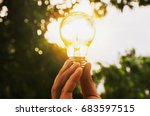 hand holding light bulb with... | Shutterstock . vector #683597515