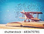 image of toy airplane and book... | Shutterstock . vector #683670781
