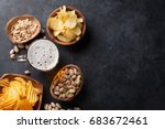 lager beer mug and snacks on... | Shutterstock . vector #683672461