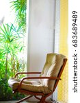 Small photo of wooden sway chair for take a rest in the corner of room