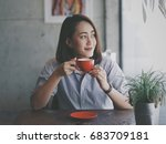 asian woman drinking coffee in... | Shutterstock . vector #683709181