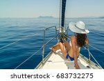 Woman Relaxing On Board Of...