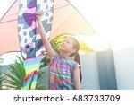 asian kid enjoyed flying kite | Shutterstock . vector #683733709