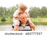 small boy is sitting on his... | Shutterstock . vector #683777557
