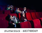 Small photo of Children in the role of adults, playing different social roles, sit in the cinema and watch movies in glasses for 3d