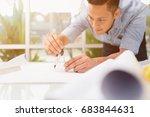 architect working on blueprint...   Shutterstock . vector #683844631