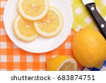 the yellow lemon and knife on... | Shutterstock . vector #683874751