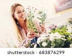 female florist working in... | Shutterstock . vector #683876299
