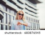 business woman looks at her... | Shutterstock . vector #683876545