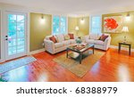 Green living room with white sofa and beautiful hardwood floor. - stock photo