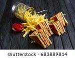 Stock photo club sandwich with french fries in metal basket 683889814
