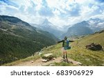 man hiking to matterhorn... | Shutterstock . vector #683906929