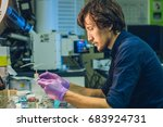 scientist in a laboratory... | Shutterstock . vector #683924731