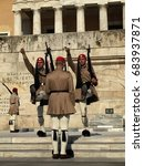 Small photo of ATHENS, GREECE - JULY 10, 2017: Guards perform Changing of the Guard ceremonies at the Presidential Mansion and at the Tomb of the Unknown Soldier, which is below the Hellenic Parliament.