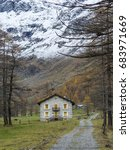 Small photo of Soana Valley, Piedmont, Italy - November 2014: Royal hunting lodge of Savoy surrounded by larch tree forest and snowy mountains.